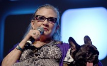 Carrie Fisher and dog Gary on stage during Future Directors Panel at the Star Wars Celebration 2016 at ExCel on July 17, 2016 in London, England.