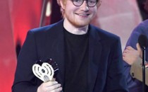 Songwriter Ed Sheeran accepts Best Lyrics for 'Love Yourself' (song by Justin Bieber) onstage at the 2017 iHeartRadio Music Awards which broadcast live on Turner's TBS, TNT, and truTV.