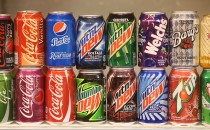 Sugary softdrinks from the USA, including Mountain Dew, Coca-Cola, 7Up and Pepsi, stand on display at a stand at the International Green Week agricultural trade fair on January 16, 2015 in Berlin.
