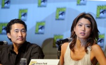 Actors Daniel Dae Kim and Grace Park speak during the 'Hawaii Five-0' panel discussion during Comic-Con 2010 at San Diego Convention Center on July 23, 2010 in San Diego, California.