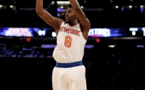 Justin Holiday #8 of the New York Knicks takes his three point shot in the fourth quarter against the Detroit Pistons at Madison Square Garden on March 27, 2017 in New York City.