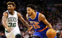 Derrick Rose #25 of the New York Knicks drives against Marcus Smart #36 of the Boston Celtics during the first half at TD Garden on January 18, 2017 in Boston, Massachusetts.