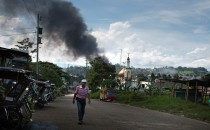 Smoke billows from the city center after an air attack by Philippine government troops on May 30, 2017 in Marawi city, southern Philippines.