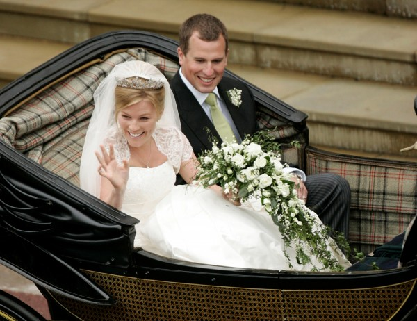 All smiles as Peter Phillips and wife, Autumn leave St. George's Chapel after wedding ceremony.