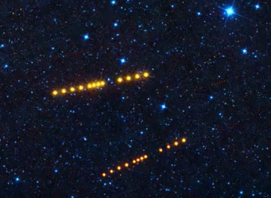 NASA Spots Strings of Bright Orange Dots Depicting Two Giant Asteroid