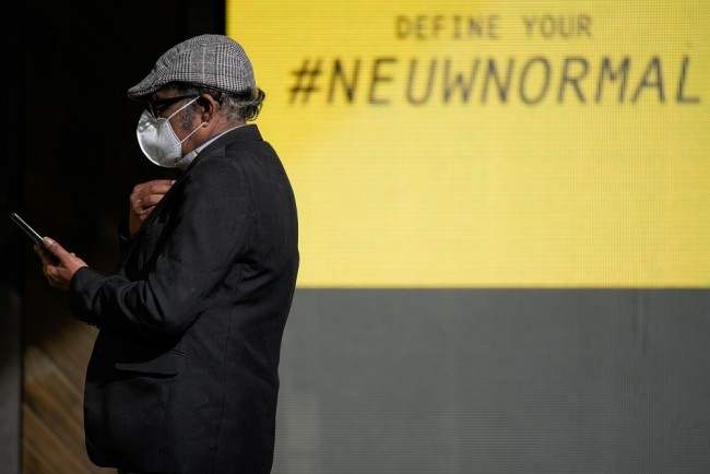 A man wears an N95 face mask in Melbourne, the first city in Australia to enforce mask-wearing to curb a resurgence of COVID-19