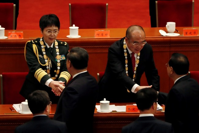 Chinese President Xi Jinping shakes hands with Chen Wei at the Great Hall of the People in Beijing
