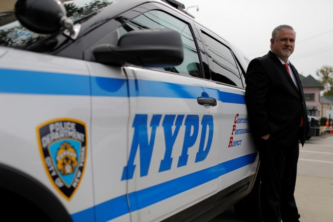 Detective Raymond Wittick, 51, a Staten Island Welfare Officer with the Detectives' Endowment Association, poses with a New York Police Department (NYPD) vehicle on Staten Island in New York City
