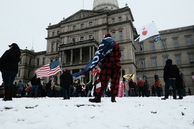 Pro-Trump Protesters Gather At State Capitols Across The Nation On Day Of Electoral College Ratification