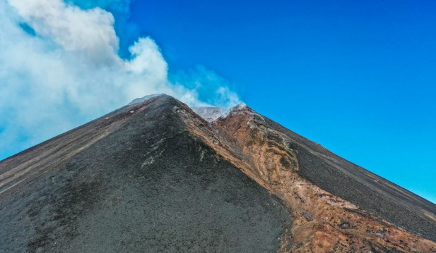 The Volcanologists Monitoring Mount Etna