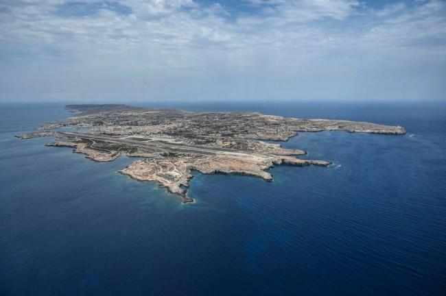 More Than 1,000 Migrants Land on Italian Island
