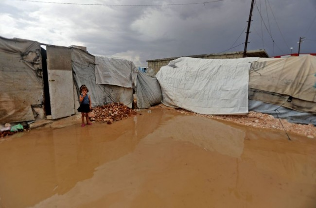 TOPSHOT-SYRIA-CONFLICT-WEATHER