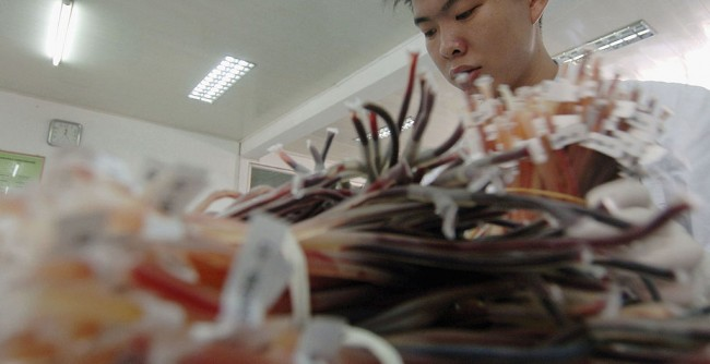 China To Test Thousands of Wuhan Blood Samples in COVID-19 Origins Probe After Denying WHO Access Caves